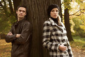 The young couple which has quarrelled during their walk in a park — Stock Photo