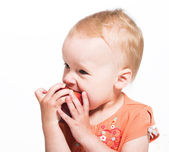 Little girl with an apple — Stock Photo