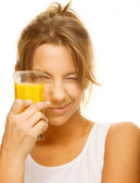 Woman drinking orange juice close up — Stock Photo