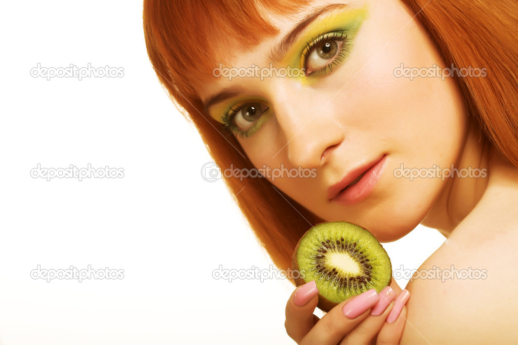 beauty red woman with kiwi on white — Stock Photo #1858328