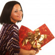 Sexy smiling girl holding a gift — Stock Photo
