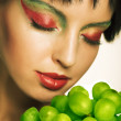 Woman with green grape — Stock Photo
