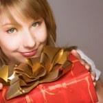 Teenage girl with present box — Stock Photo
