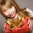 Stock Photo: Teenage girl with present box