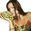 Woman with bunch of grapes — Stock Photo #1861286