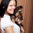 Stock Photo: Young girl with her Yorkie puppy