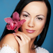Woman with orchid flower - Stock Photo