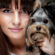 Young girl with her Yorkie puppy - Stok fotoraf