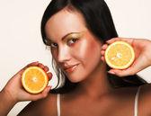 Cheerful woman with fresh orange — Stock Photo