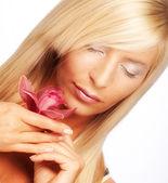 Mujer con flores — Foto de Stock