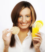 Young woman drinking orange juice — Stock Photo