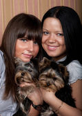 Two girls with puppys — Stock Photo