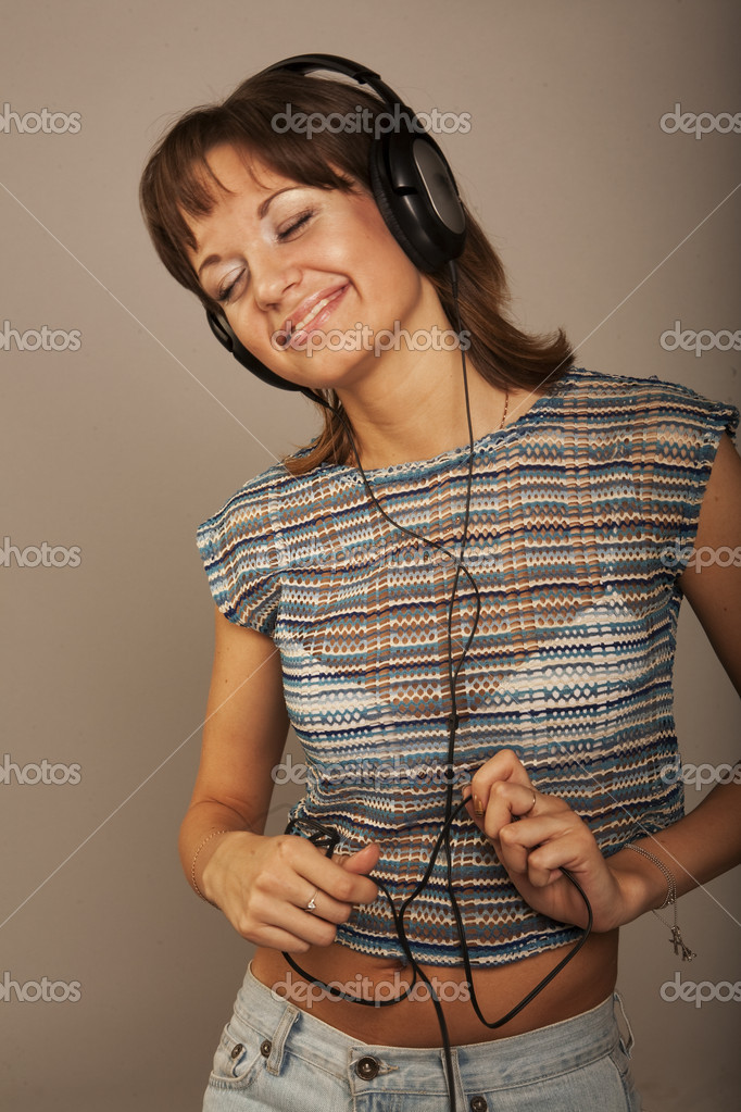 Girl Listening to Music. Studio shot.  Stock Photo #1861279