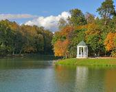 Rotunda near to water in autumn trees — Stock Photo