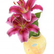 Lilies in a yellow vase - Stock Photo