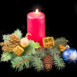 Candle and New Year's ornaments — Stock Photo