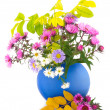Flowers in blue vase — Stock Photo