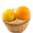 Lemon in basket on white background — Stock Photo