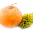 Pumpkin and green sweet tasty grapes - Stock Photo