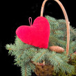 Red heart in basket with tree — Stock Photo