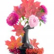Stock Photo: Red maple leaves in black vase
