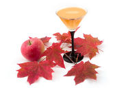 Apple and wine with maple leaves — Stock Photo