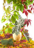 Autumn bouquet in yellow vase — Stock Photo