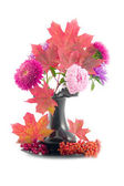 Red maple leaves in black vase — Stock Photo