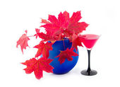 Vase with maple red autumn leaves — Stock Photo
