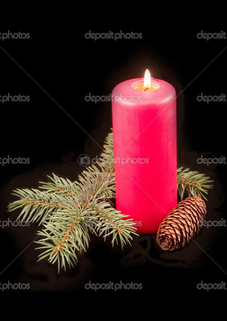 Red celebratory burning candle with furtree green branch on a black background — Stock Photo #1771431