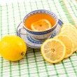 Tasty fragrant tea with lemon - Stock Photo