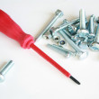 Turn-screw with nails and bolts — Stock Photo