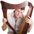 Man with harp - Stock Photo