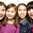 Four happy and smiling young girls — ストック写真