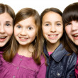 Four happy and smiling young girls — Stockfoto