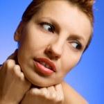 Beautiful woman on blue background — Stock Photo
