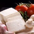 Slices of fresh white cheese - Stock Photo