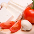 Feta cheese with tomato and mushrooms — Stock Photo