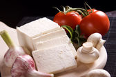 Slices of fresh white cheese — Stock Photo