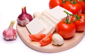 Cheese and tomato on white background — Stock Photo