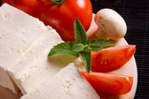 White cheese with tomato and mushroom — Stock Photo