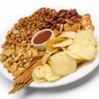 Potato chips and salty snacks — Stock Photo
