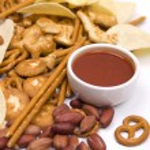 Salty snacks and salsa dip — Stock Photo