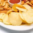 Salty snacks served on a plate — Stock Photo