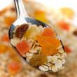 Fruit muesli in a spoon — Stock Photo #1805511