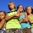 Stock Photo: Gang of four serious kids