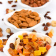 Dried fruit and nuts isolated on white — Stock Photo