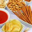 Potato chips and other salty snacks - Stock Photo