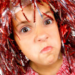 Stock Photo: Young girl with carnival wig