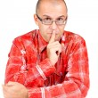 Middle aged man with finger on his mouth — Stock Photo